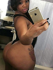 Sweet looking black girl taking selfies