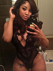 Hot black amateur poses and takes selfies
